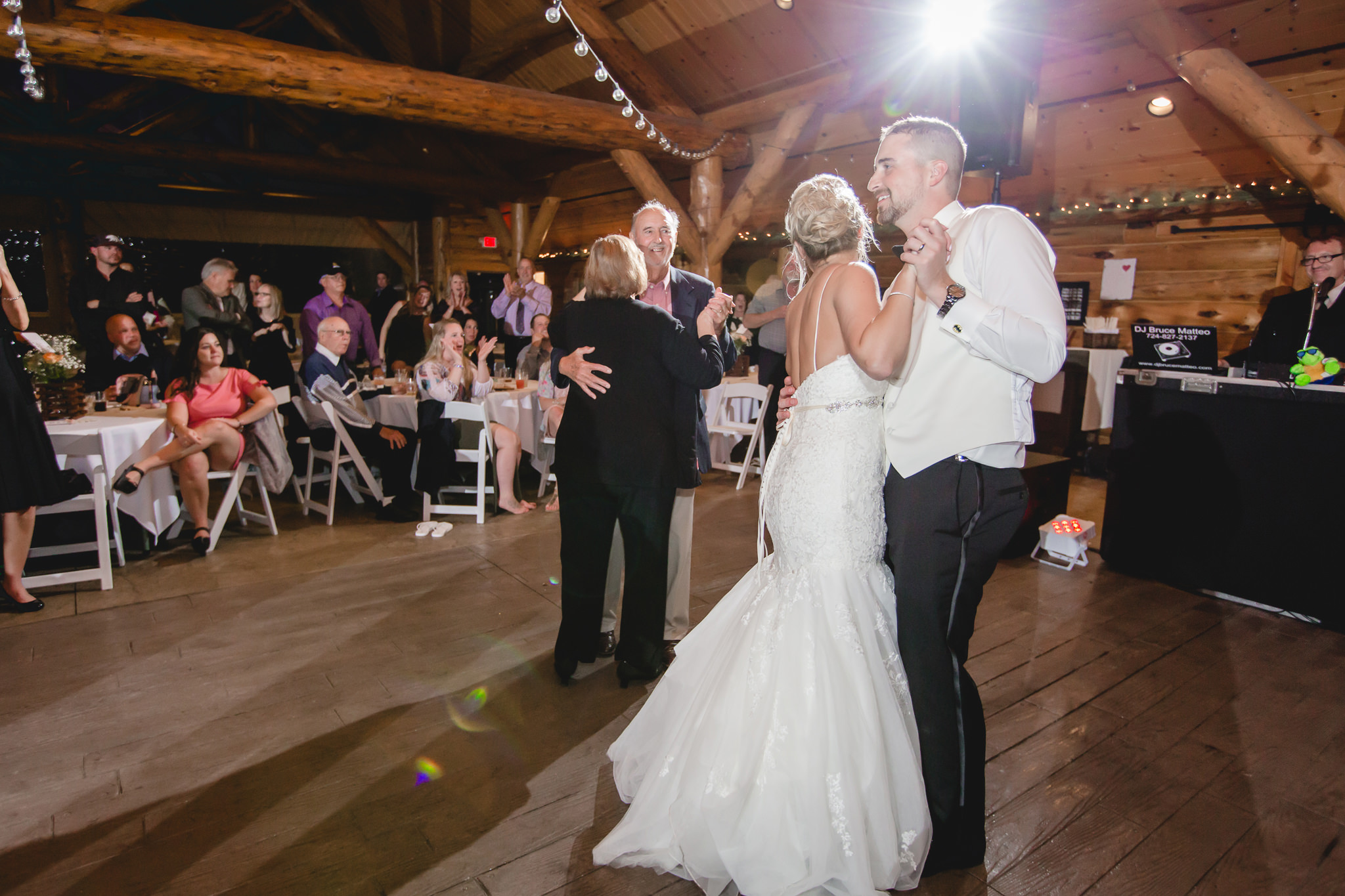 Bride and groom dance with their grandparents at the Gathering Place at Darlington Lake