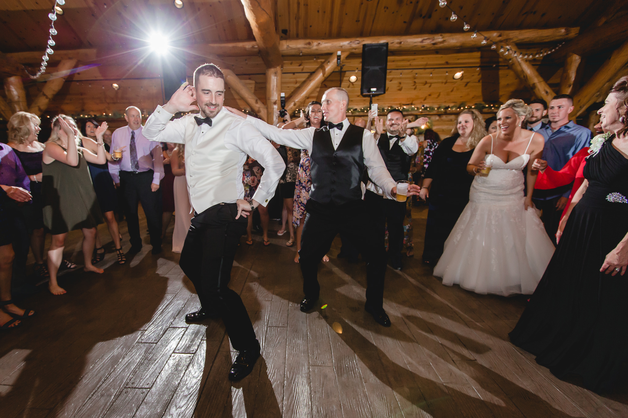 Groom dances with his father at the Gathering Place at Darlington Lake