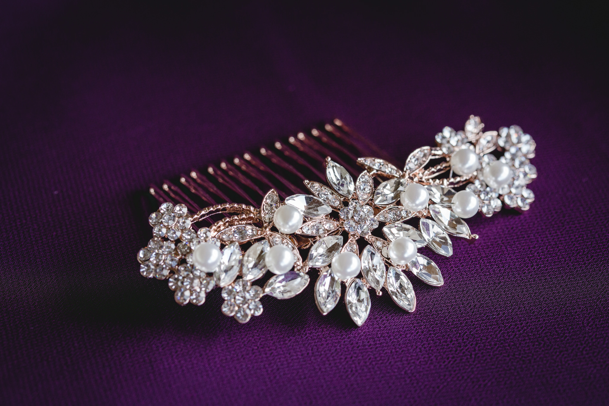Diamond and rose gold hair clip on a purple bridesmaids dress