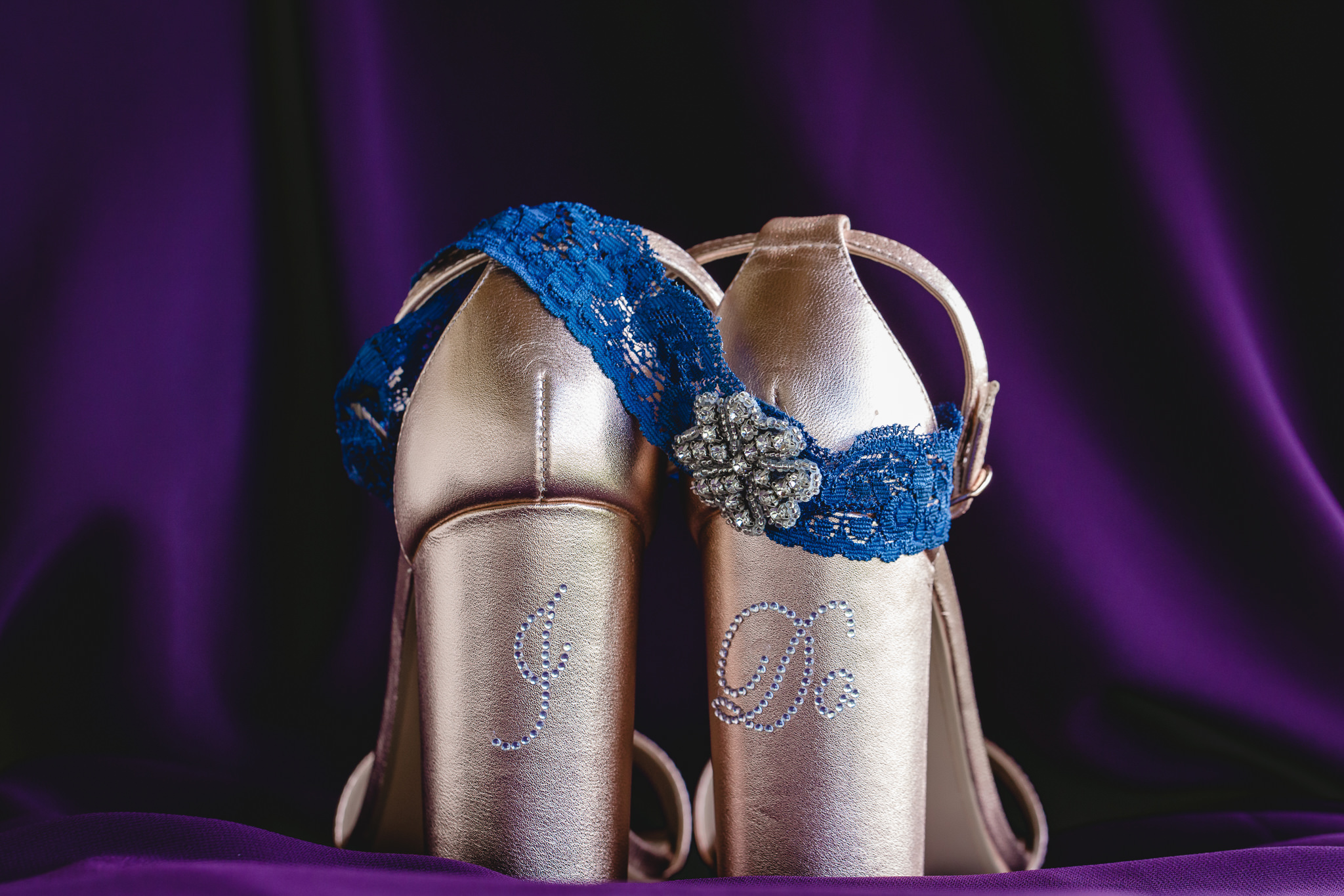 Rose gold shoes and blue garter before a wedding at White Barn in Prospect PA