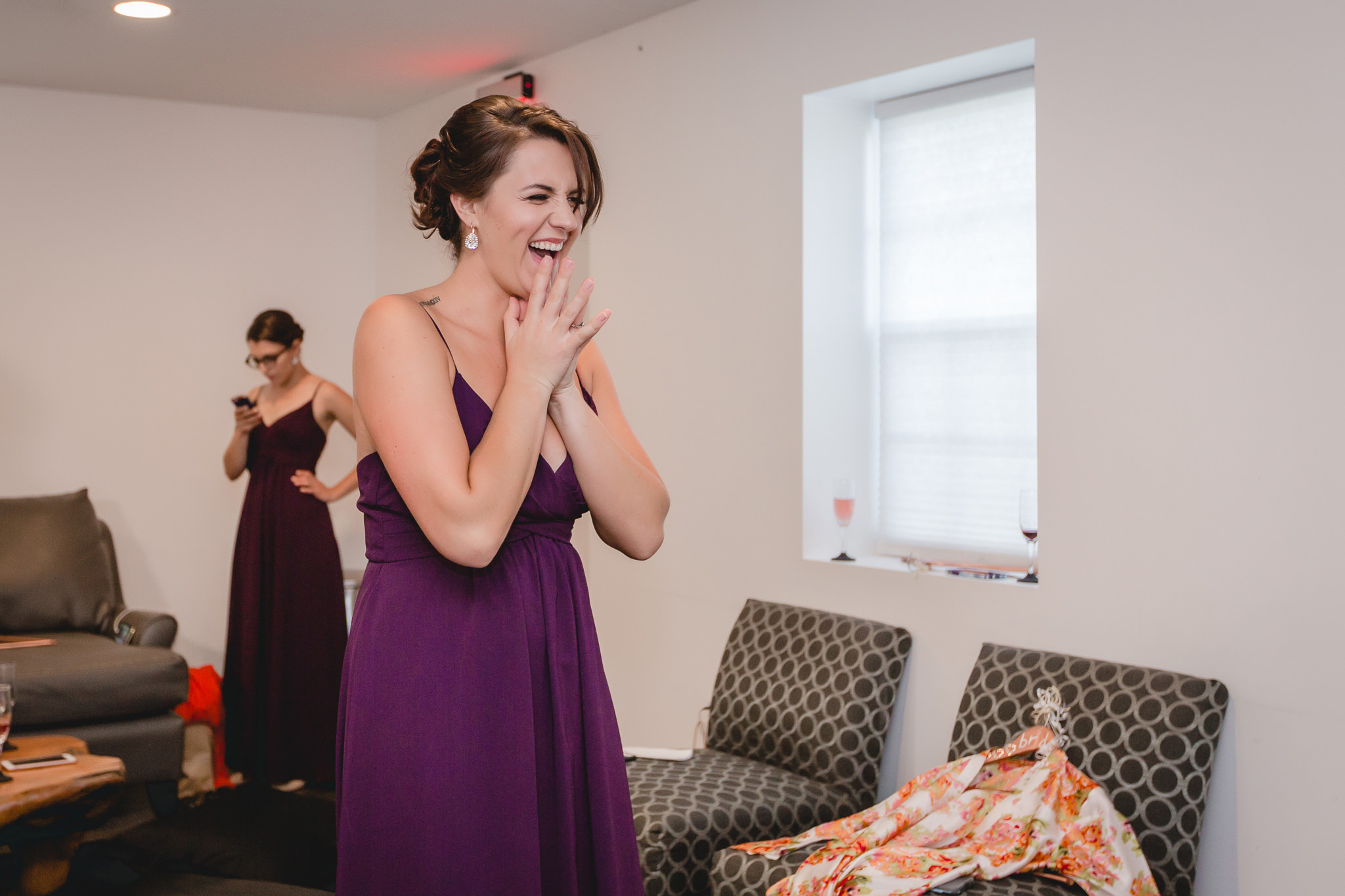 Bridesmaid reacts to seeing the bride in her dress at White Barn in Prospect PA