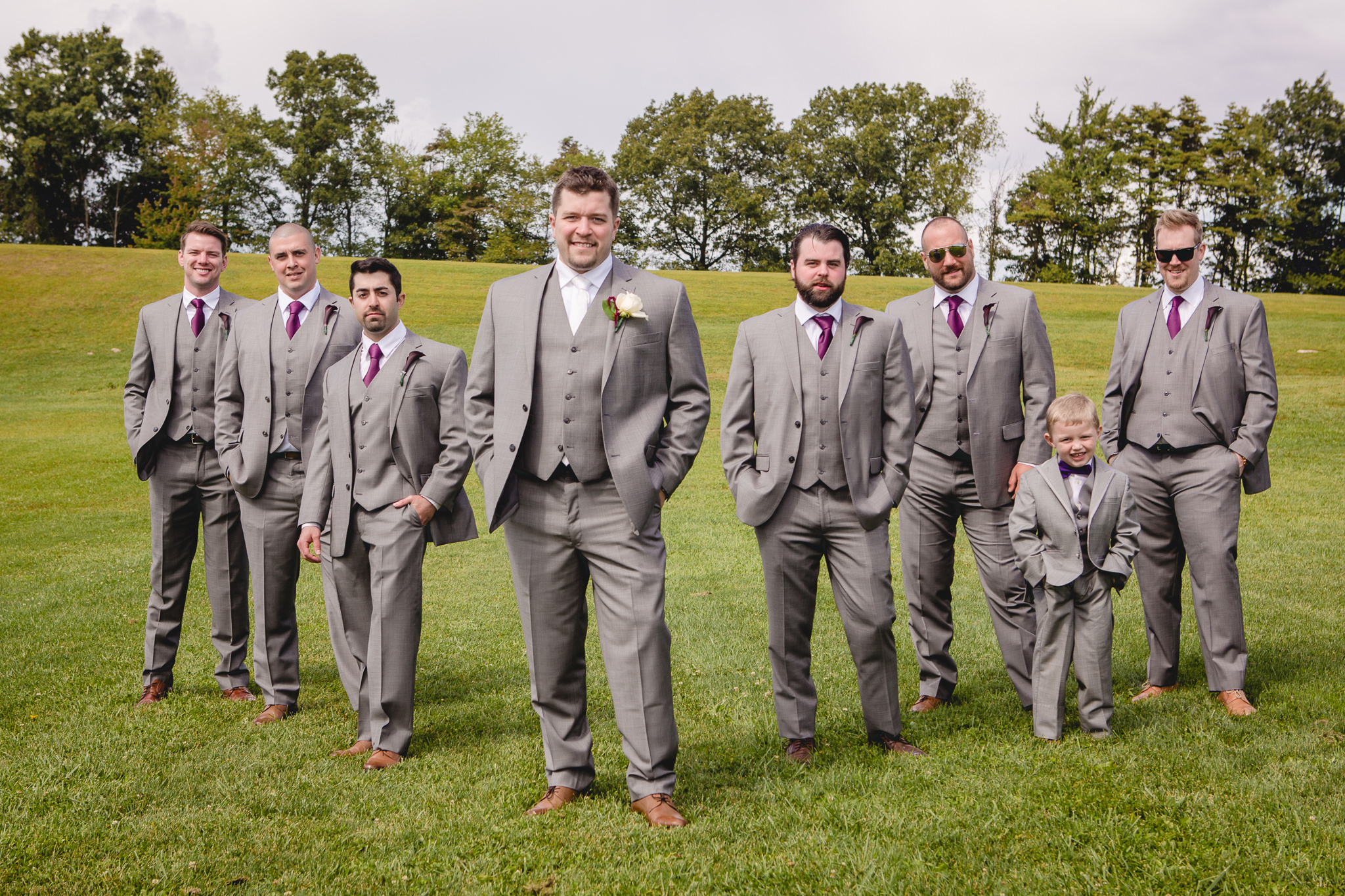 Groom and groomsmen at the White Barn before a September wedding