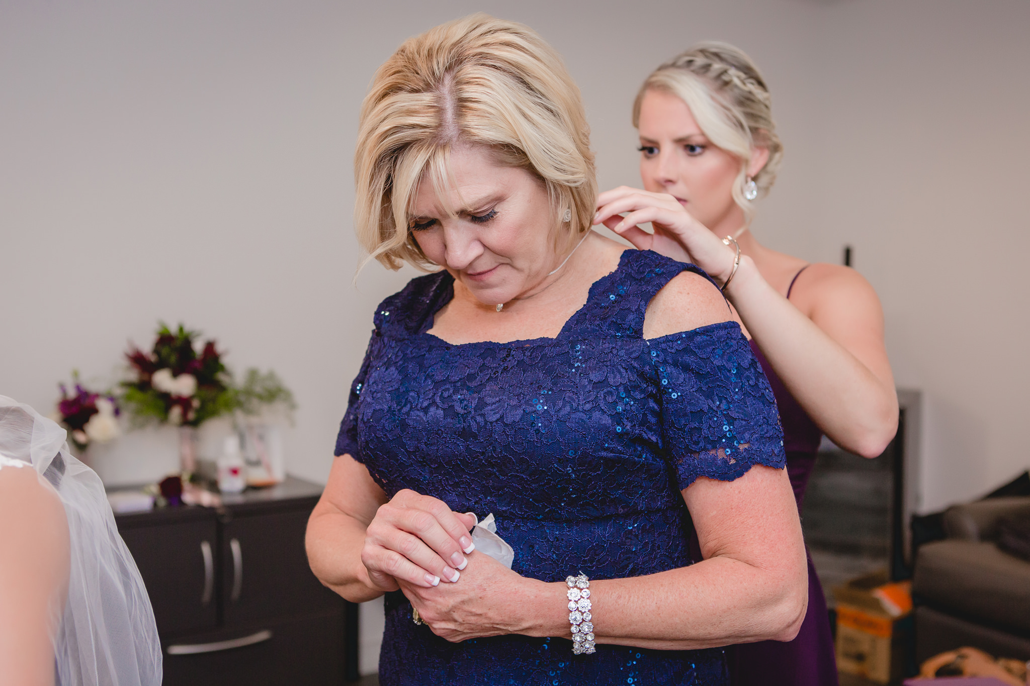 Mother of the groom receives a necklace as a wedding day gift