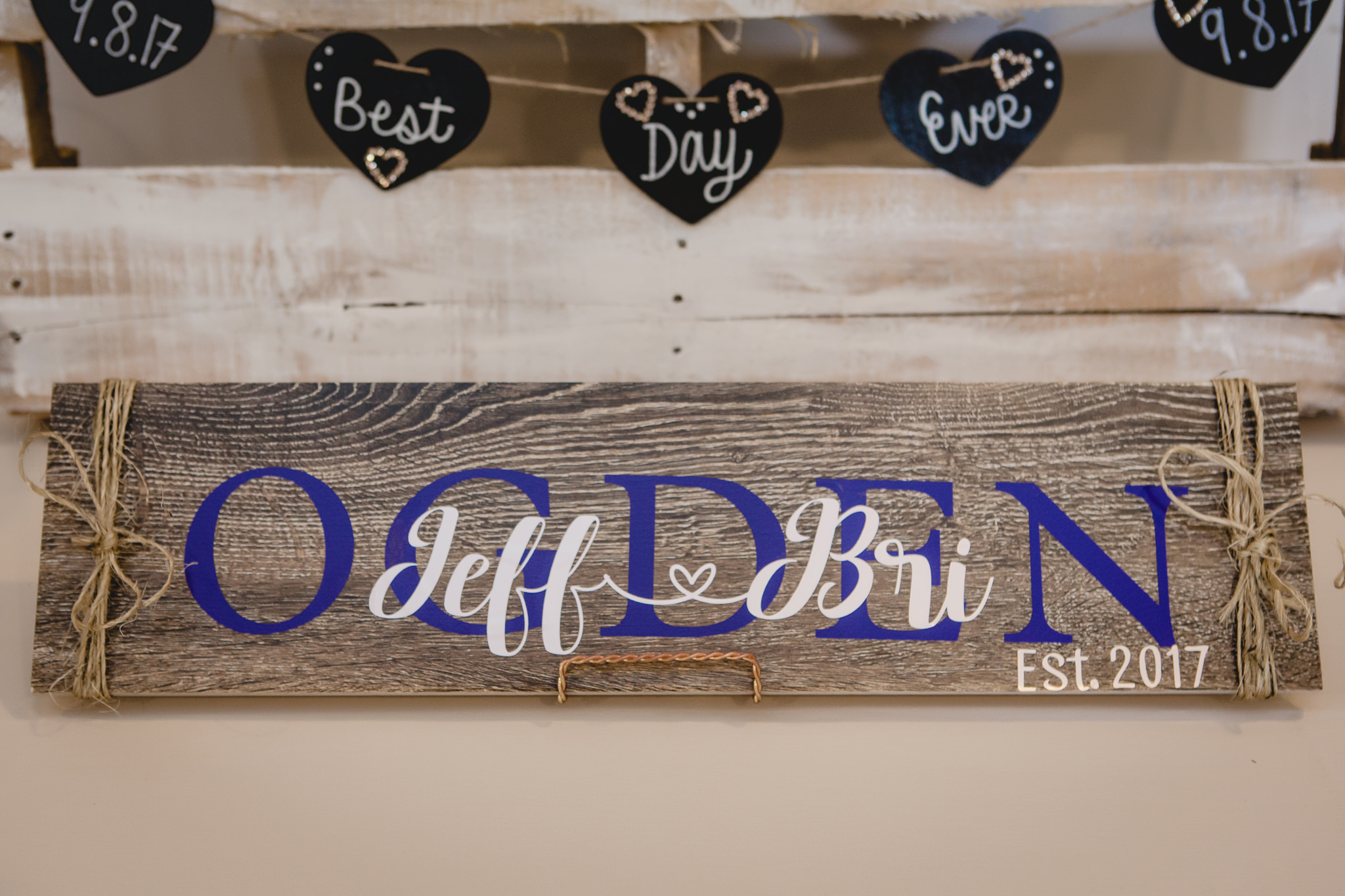 Personalized sign at a White Barn wedding reception