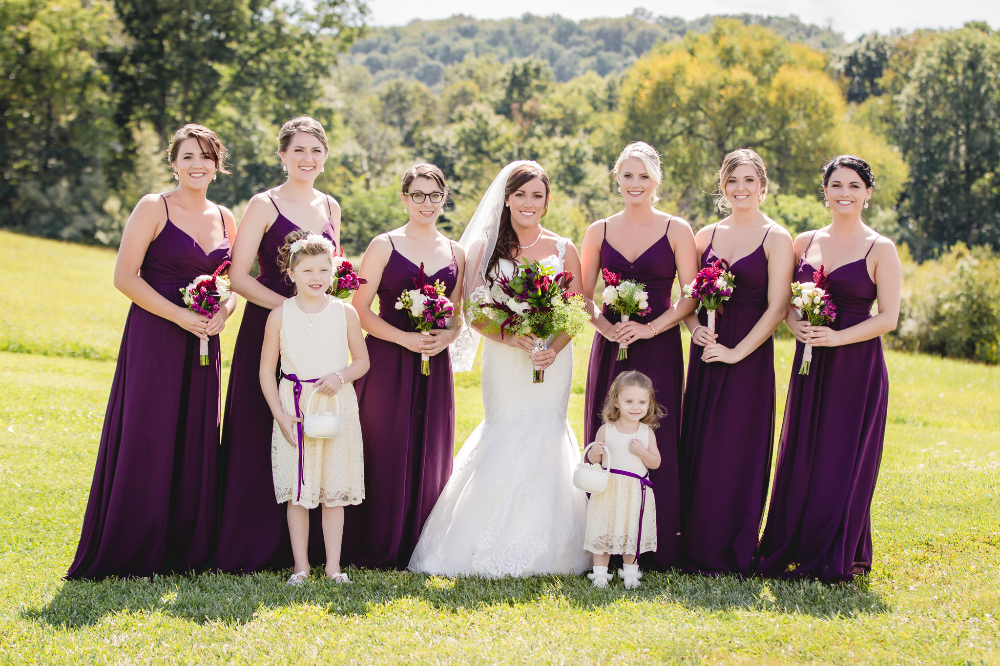 Bride with her bridesmaids before her wedding ceremony at White Barn