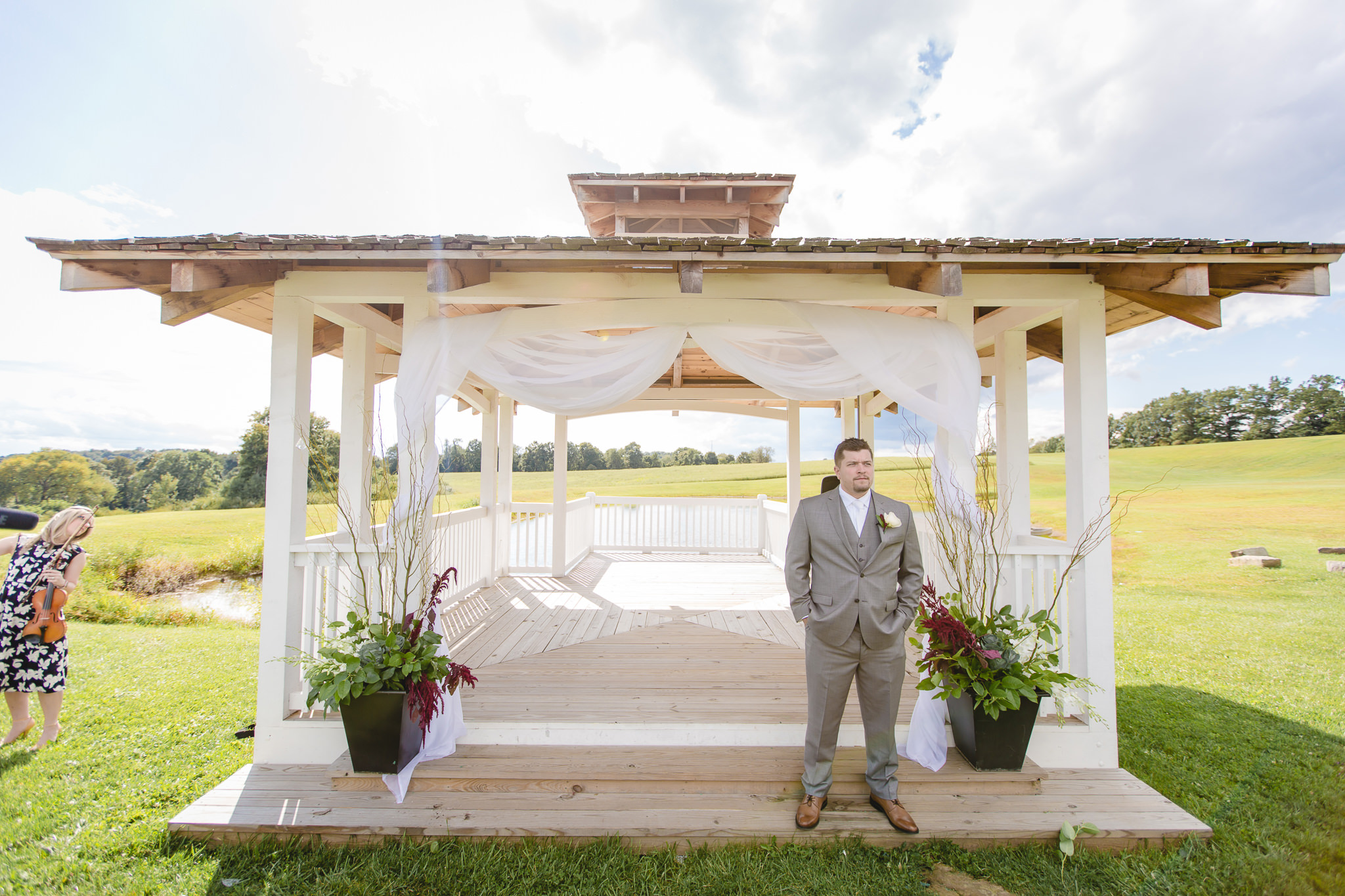 Groom gets in place for his outdoor wedding ceremony at White Barn