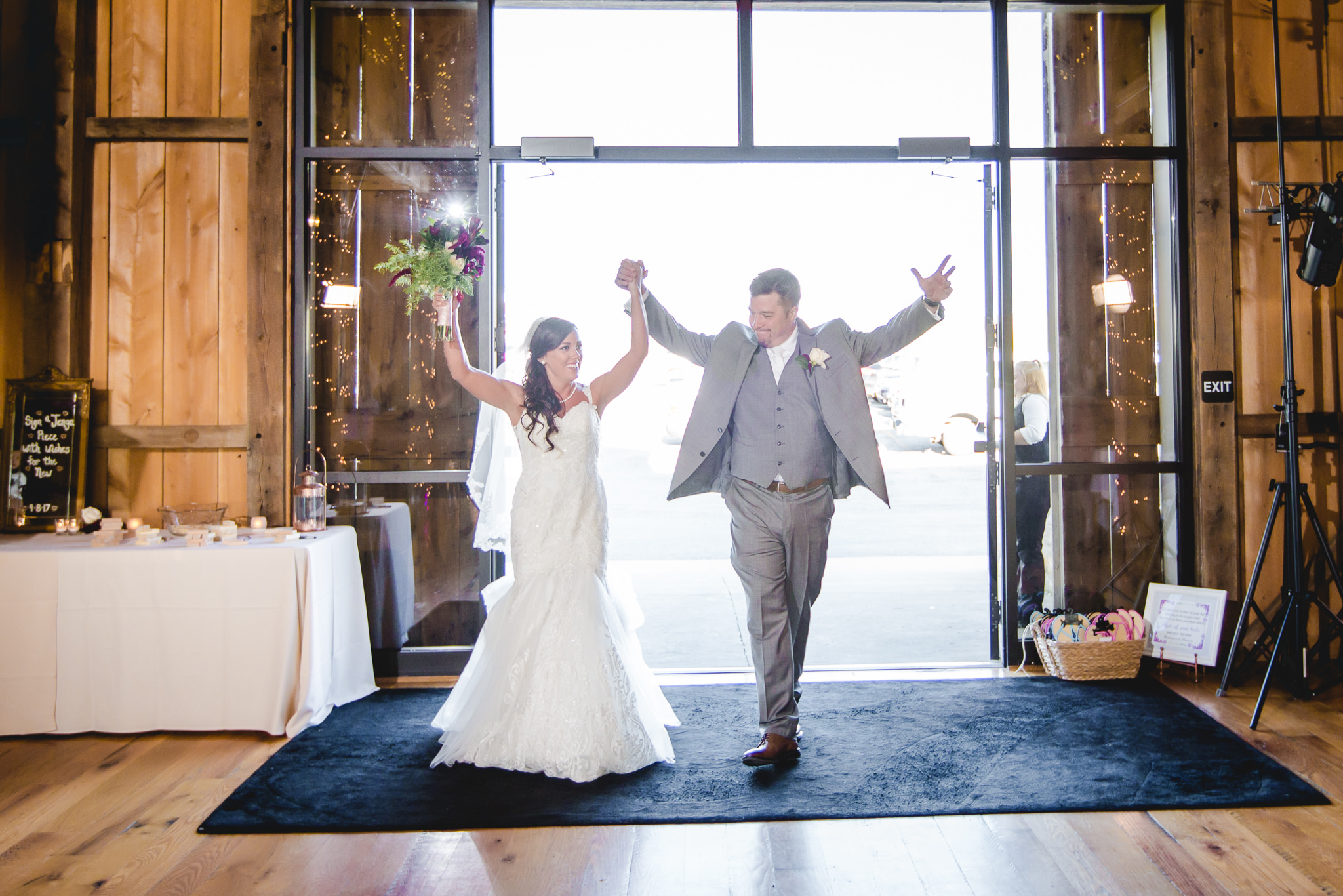 Bride and groom enter their reception at White Barn in Prospect PA