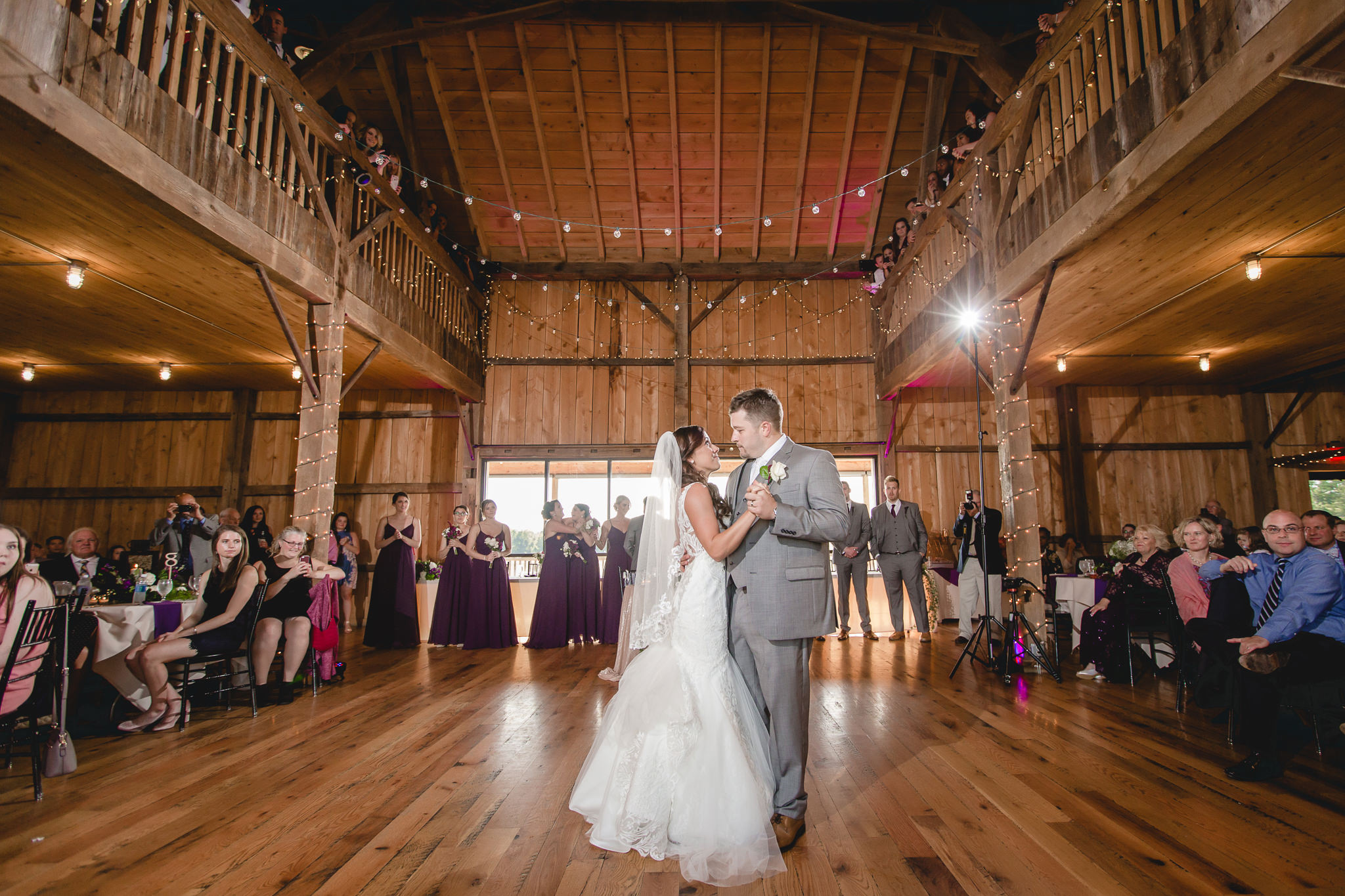Bride and groom share a first dance at their White Barn wedding reception