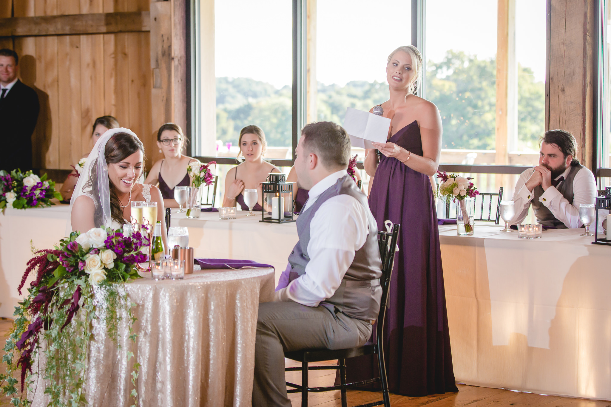 Maid of honor gives a speech at a White Barn wedding reception