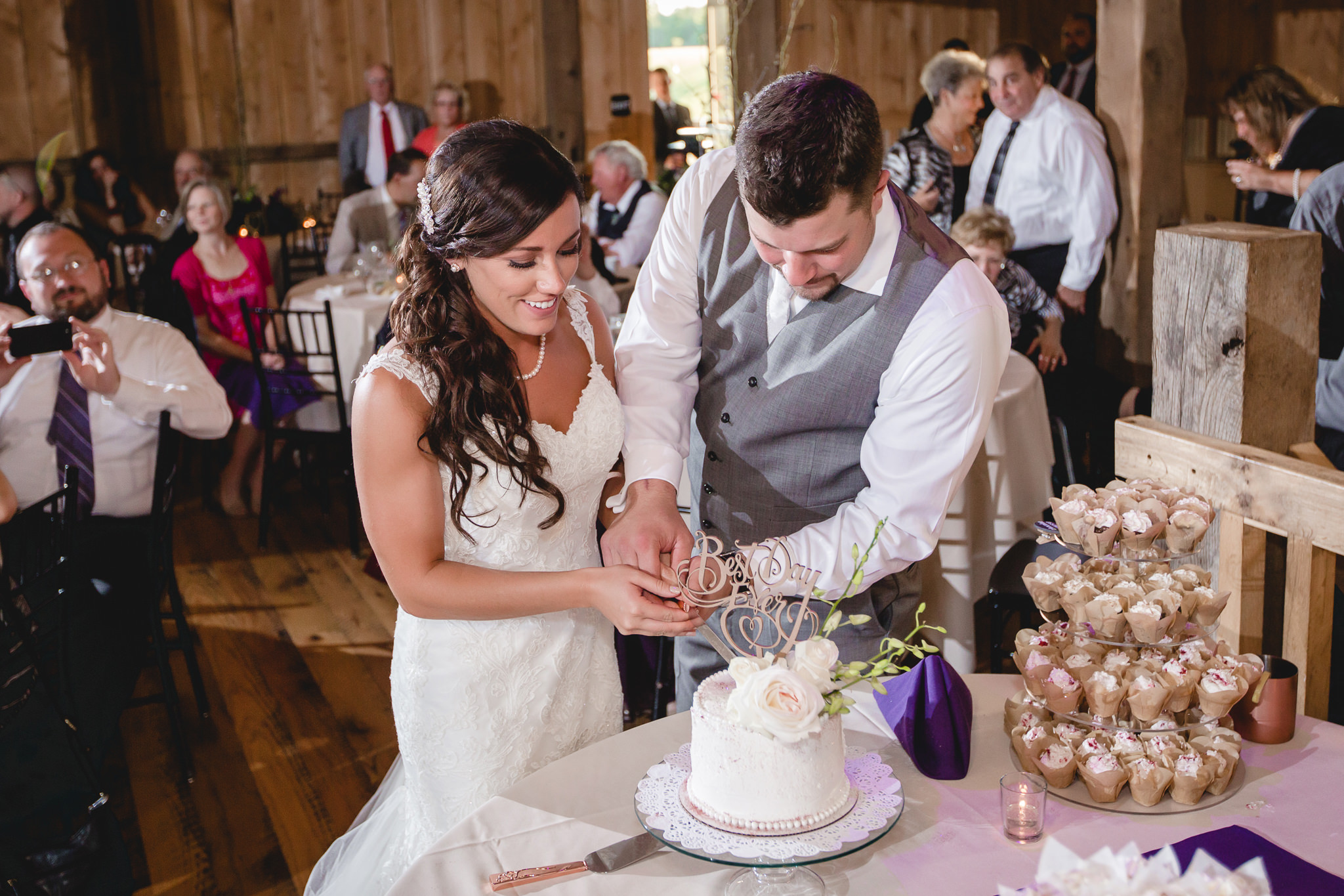 Bride and groom cut their cake at White Barn