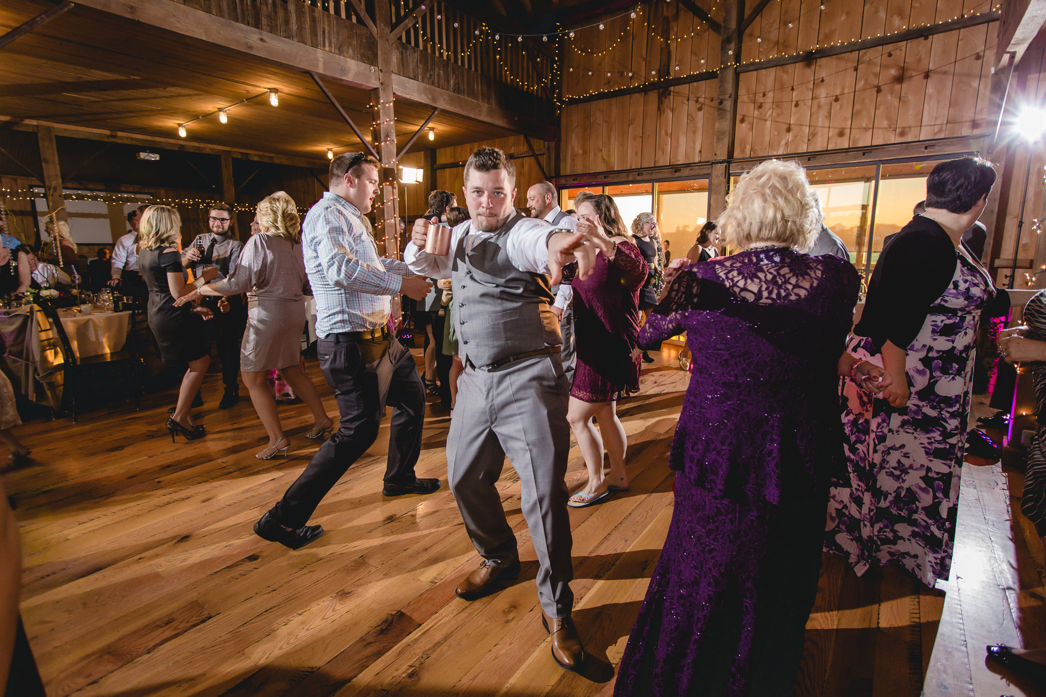 Groom dances with his Moscow Mule at White Barn