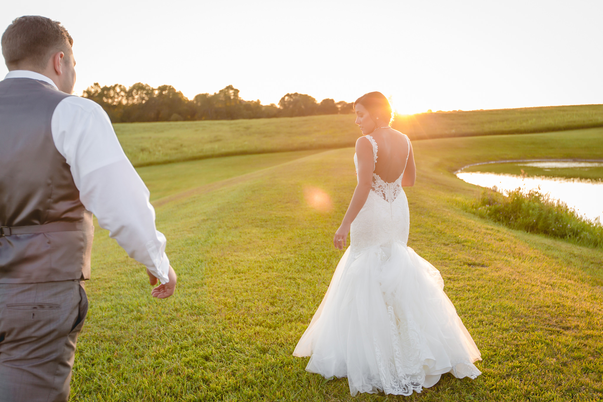 Bride walks into the sunset at White Barn