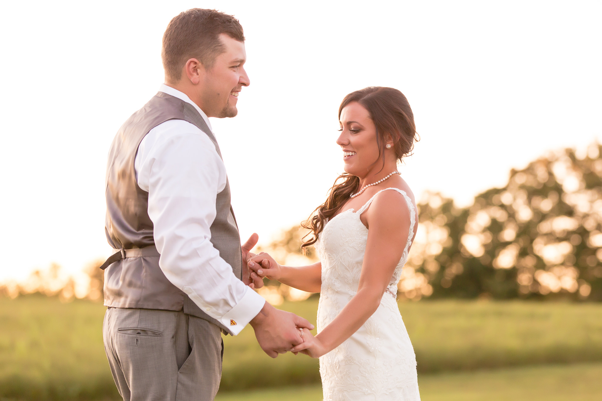 Bride and groom playfully interact at White Barn