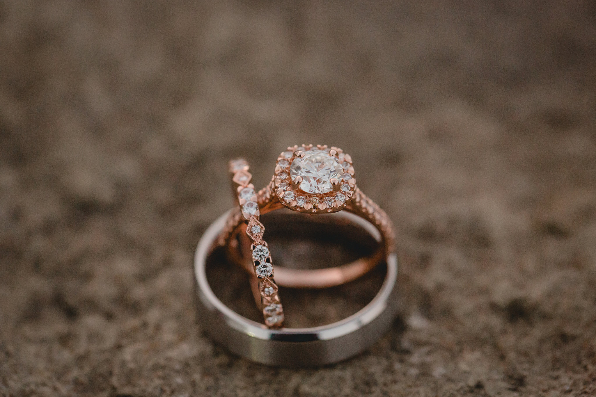 Rose gold and diamond engagement ring and wedding bands at White Barn