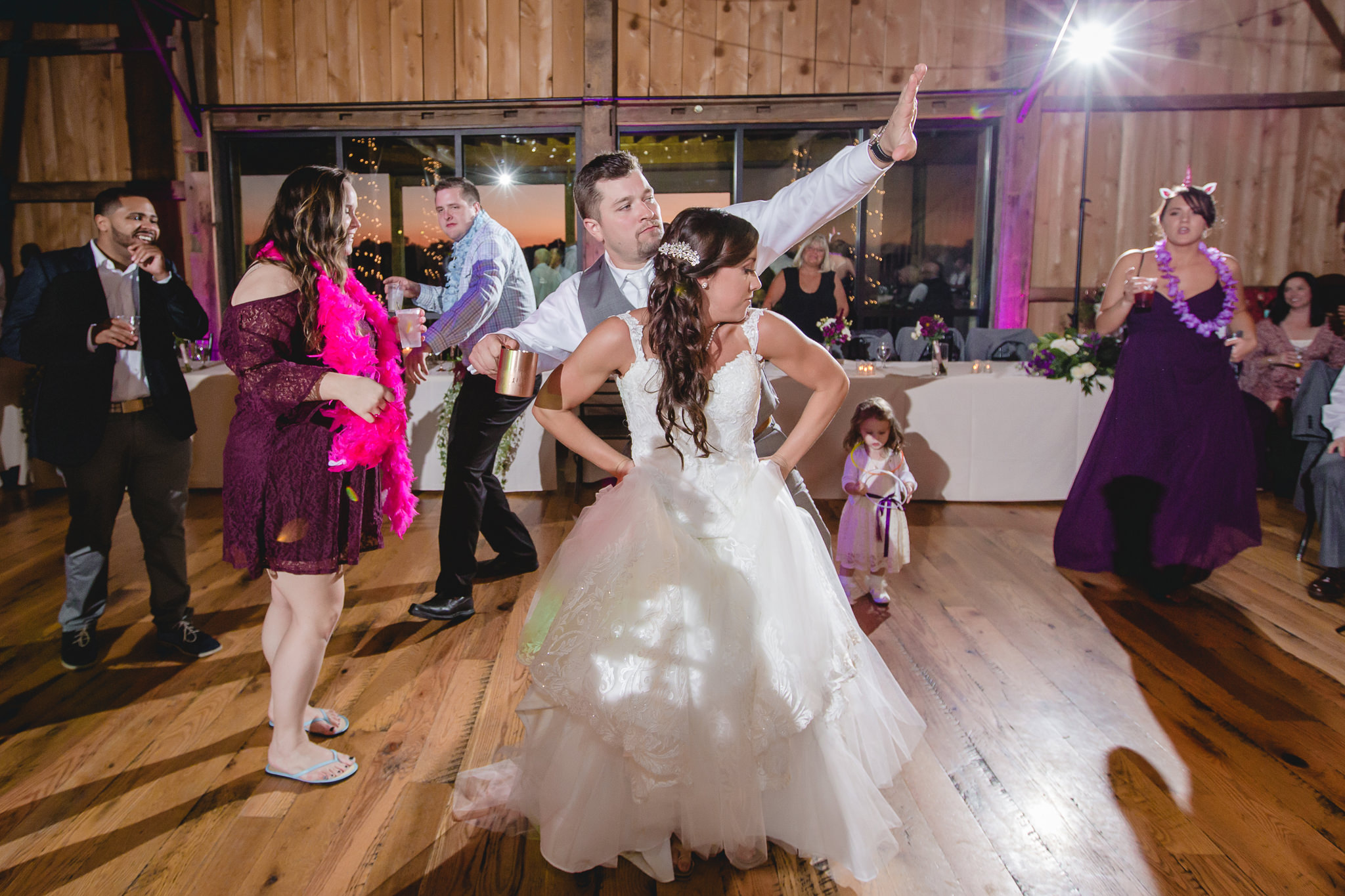 Bride and groom dance to the music at White Barn