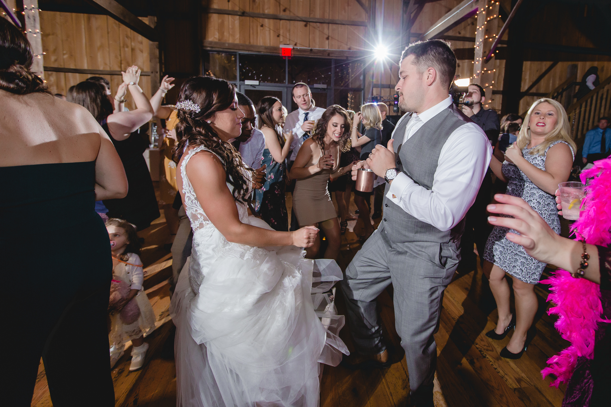 Bride and groom bust a move at their White Barn wedding