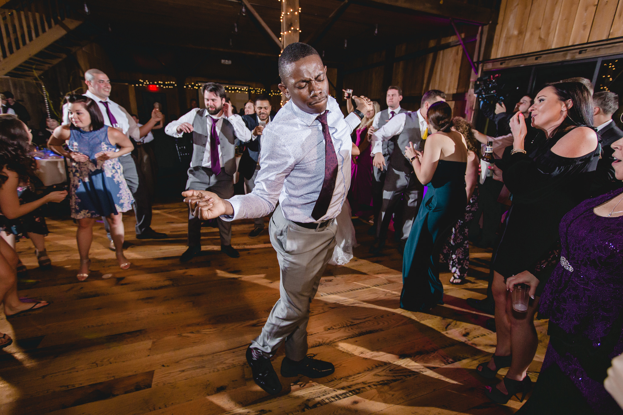Guests dance at a wedding reception at White Barn