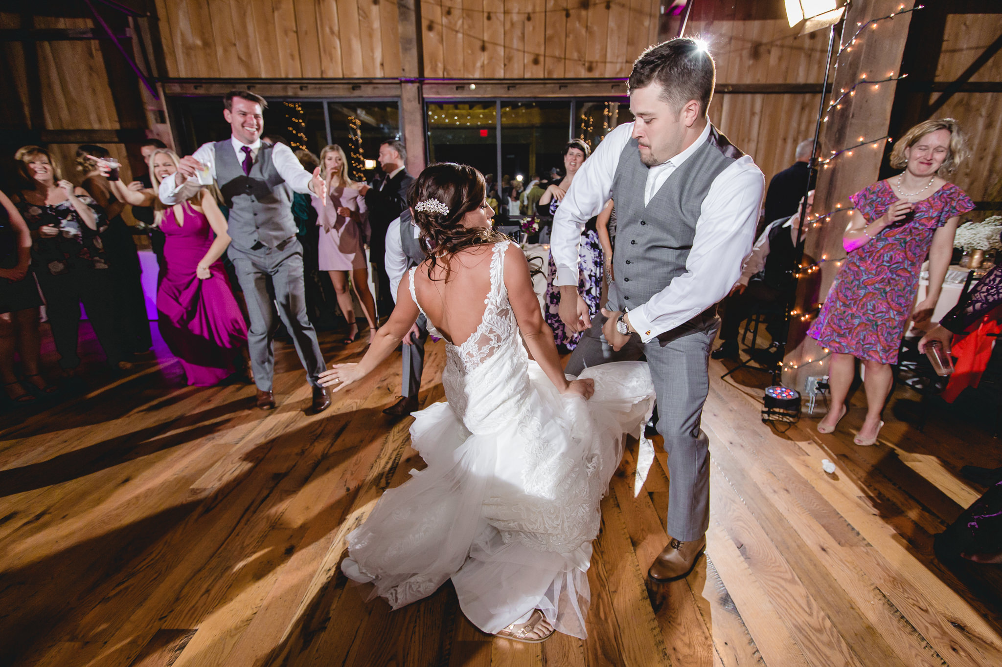 Bride and groom show off their dance moves at their White Barn wedding