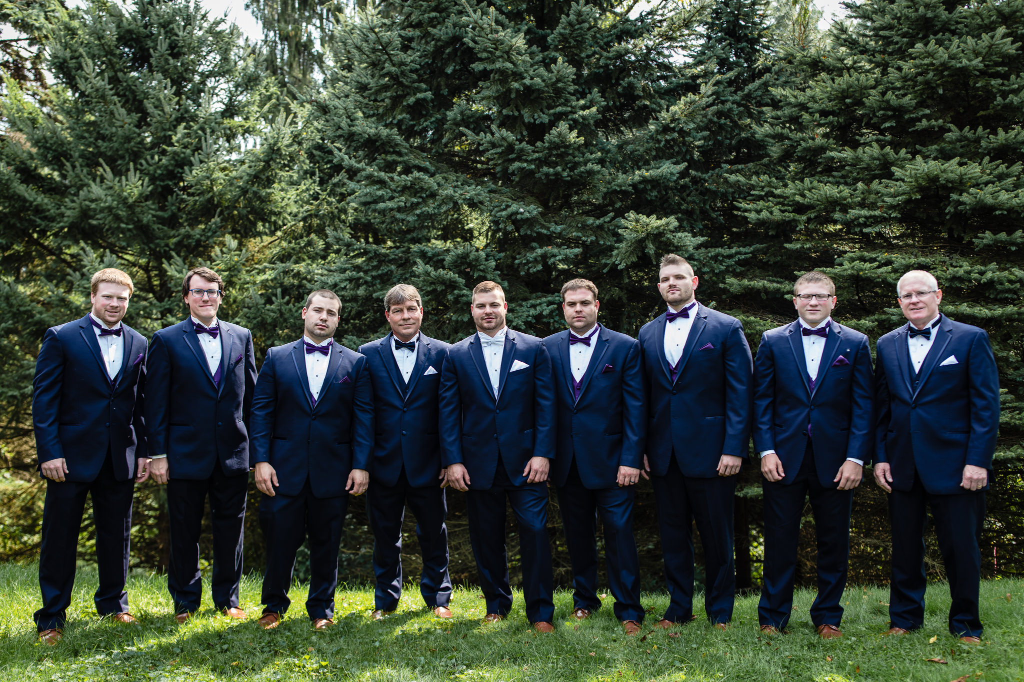 Groom poses with his groomsmen and fathers before his wedding at the Fez