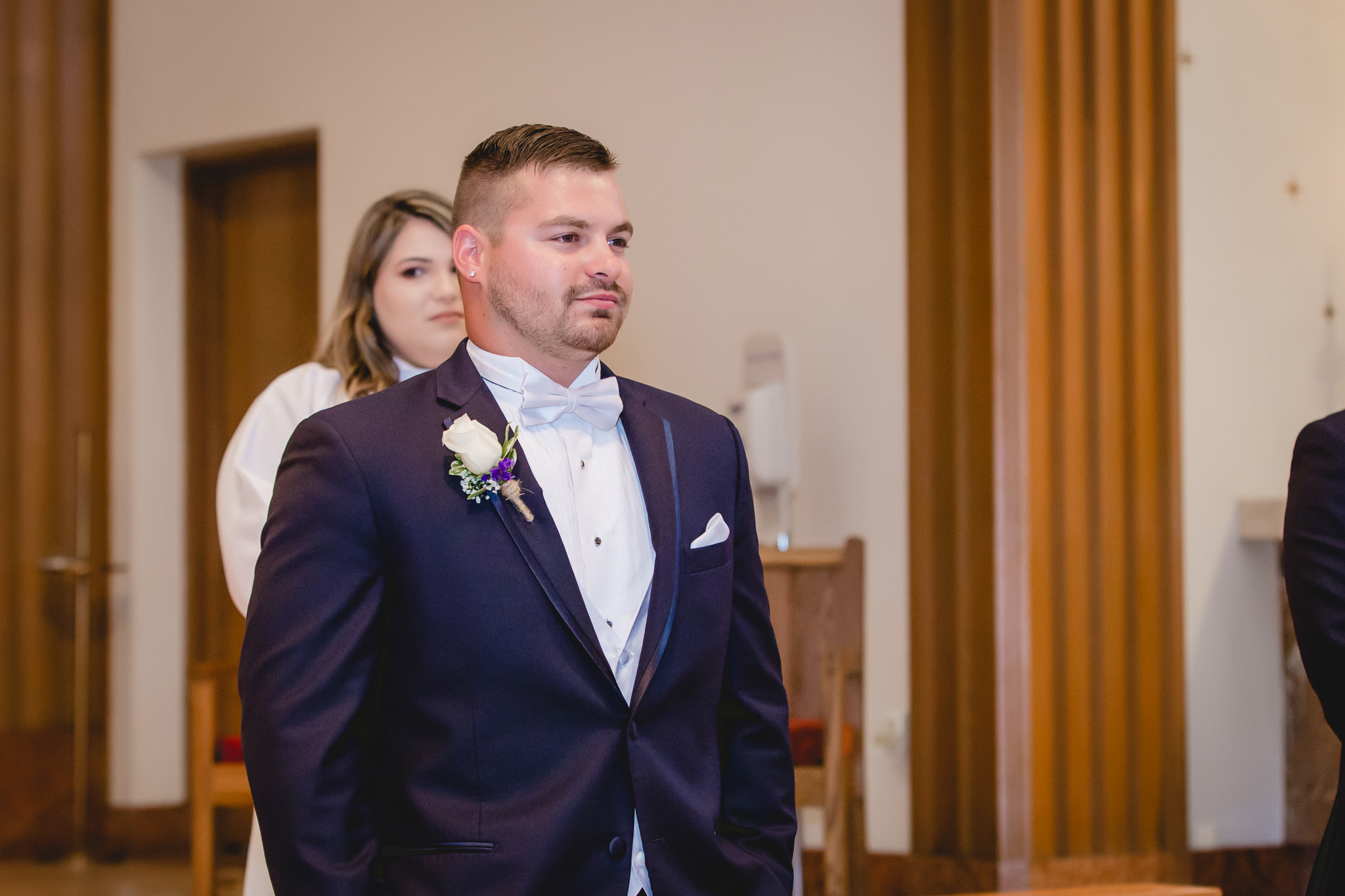 Groom sees his bride coming down the aisle at St. Titus Church