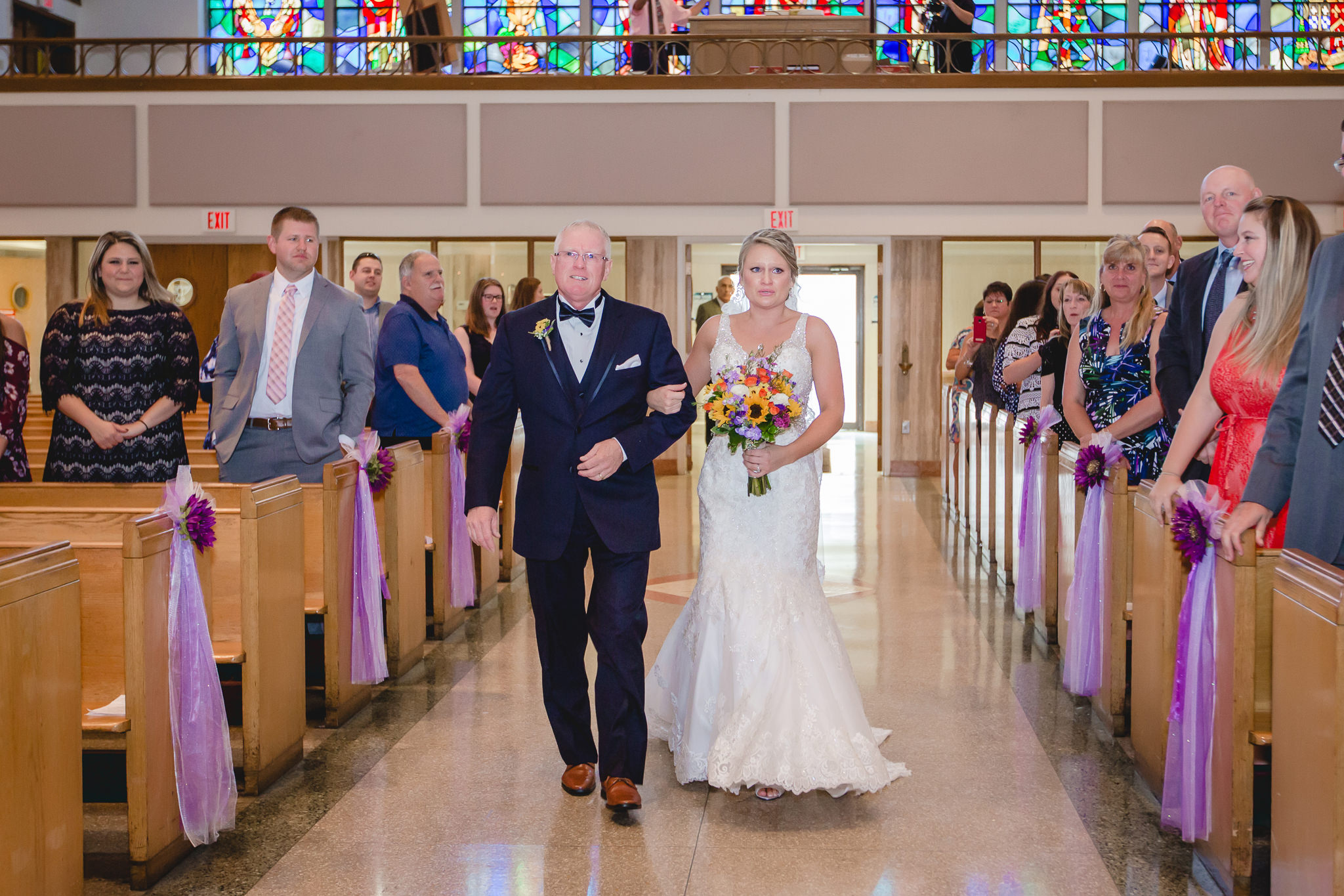 Father of the bride walks his daughter down the aisle at St. Titus Church