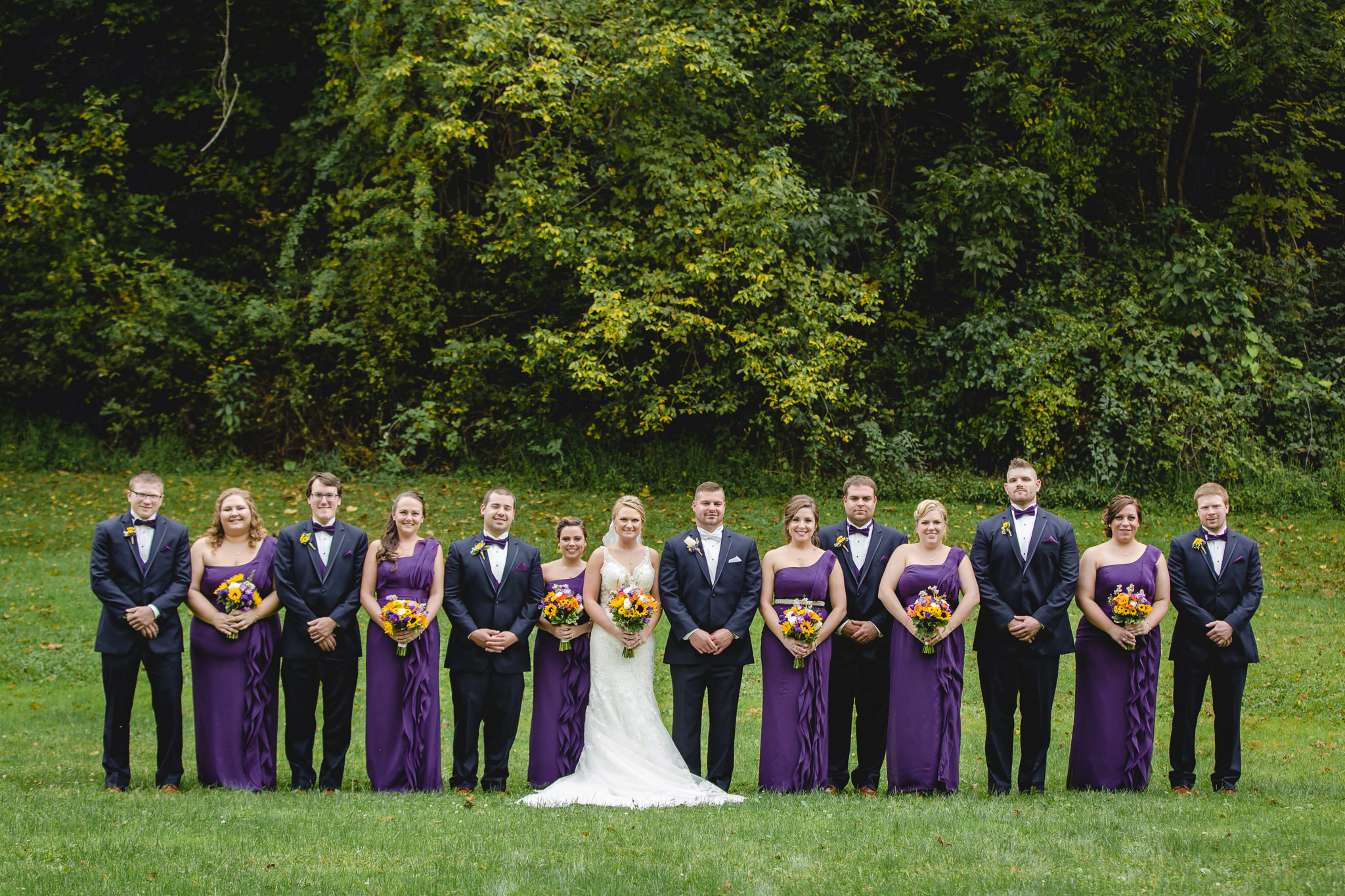 Bridal party poses in a Moon Township park before a wedding reception at the Fez