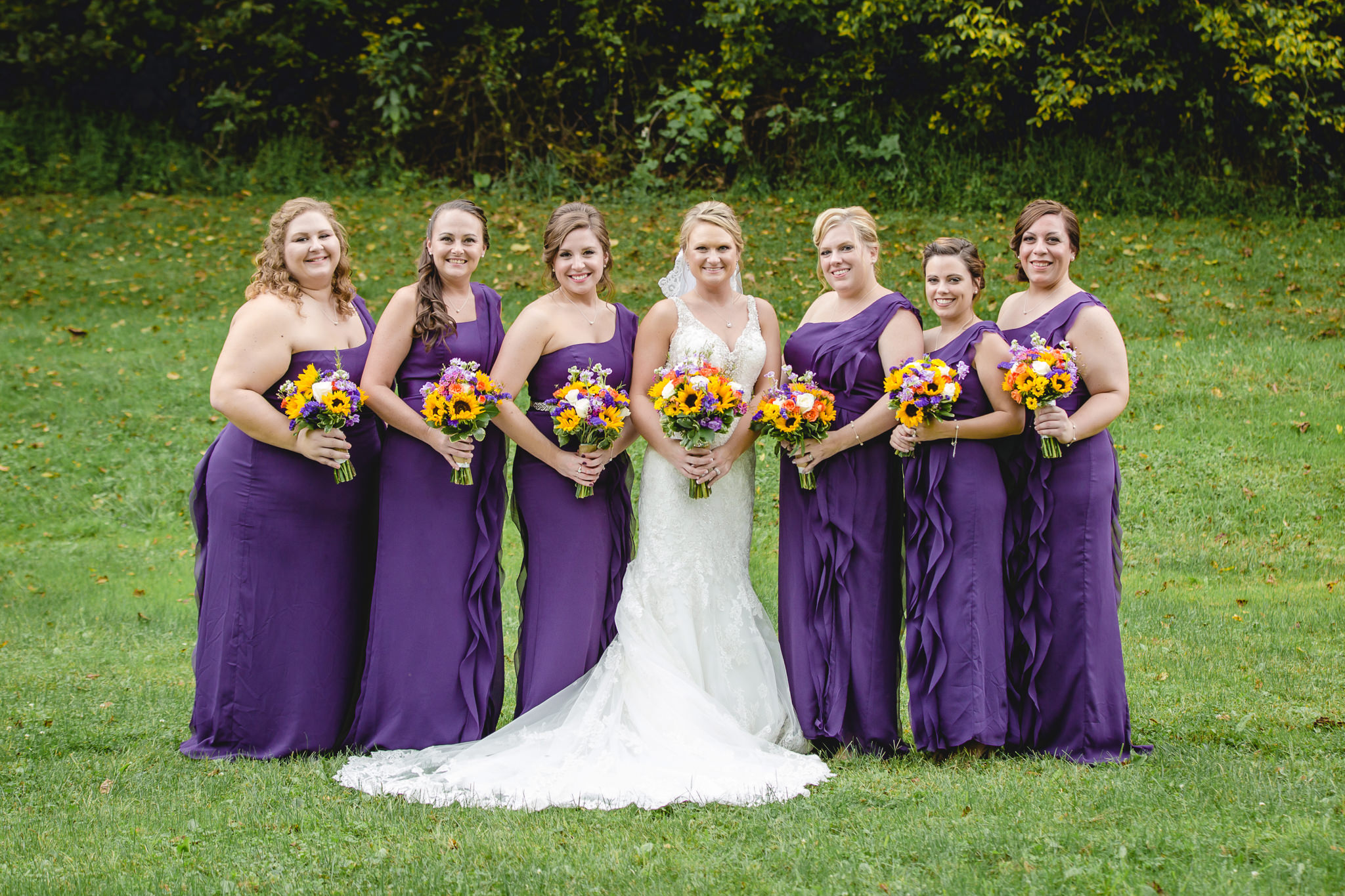 Bridesmaids pose in purple dresses in Moon Township PA