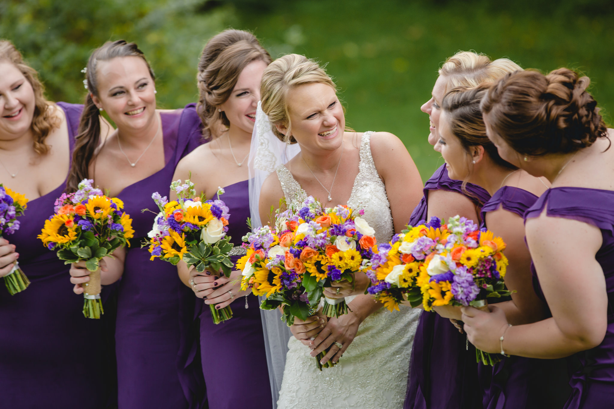 Bride laughs with her bridesmaids before her wedding at the Fez