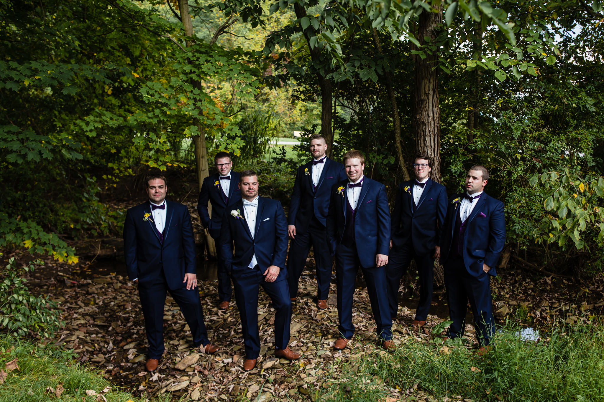 Groom and groomsmen in the woods in a Moon Township park