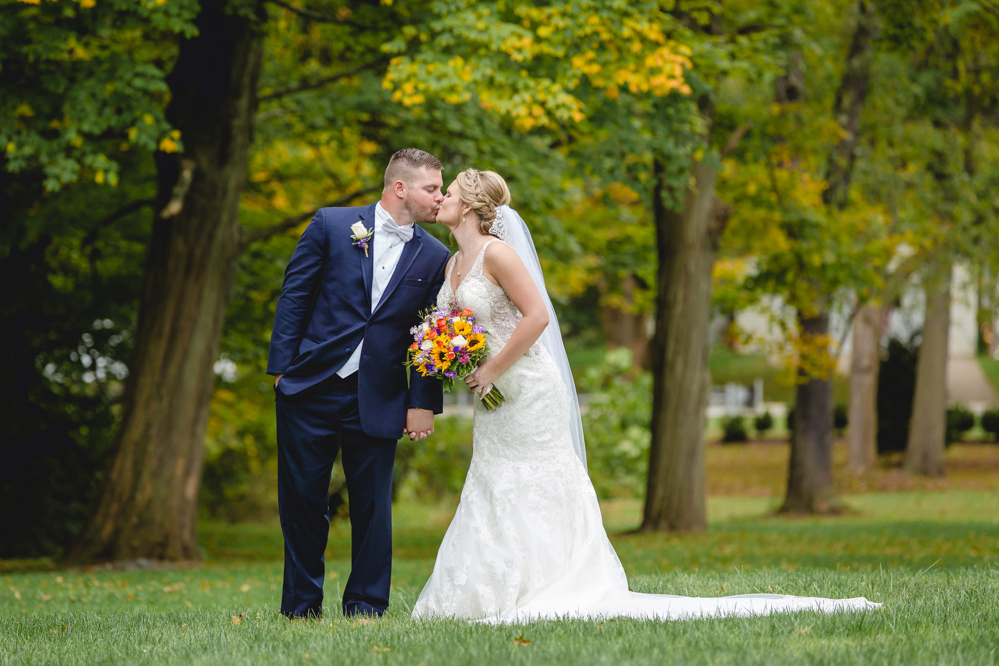 Bride and groom kiss in a Moon Township park before their wedding at the Fez