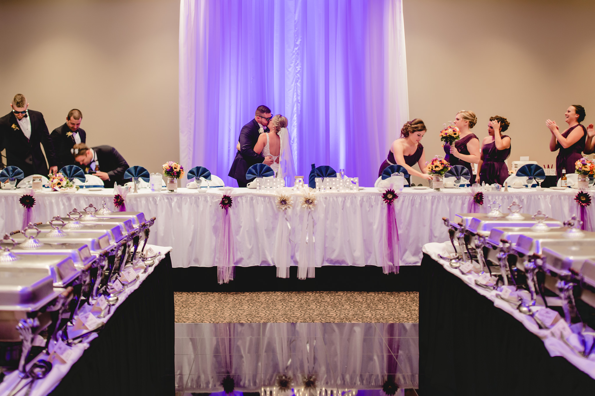 Bride and groom kiss during intros at their Fez wedding reception