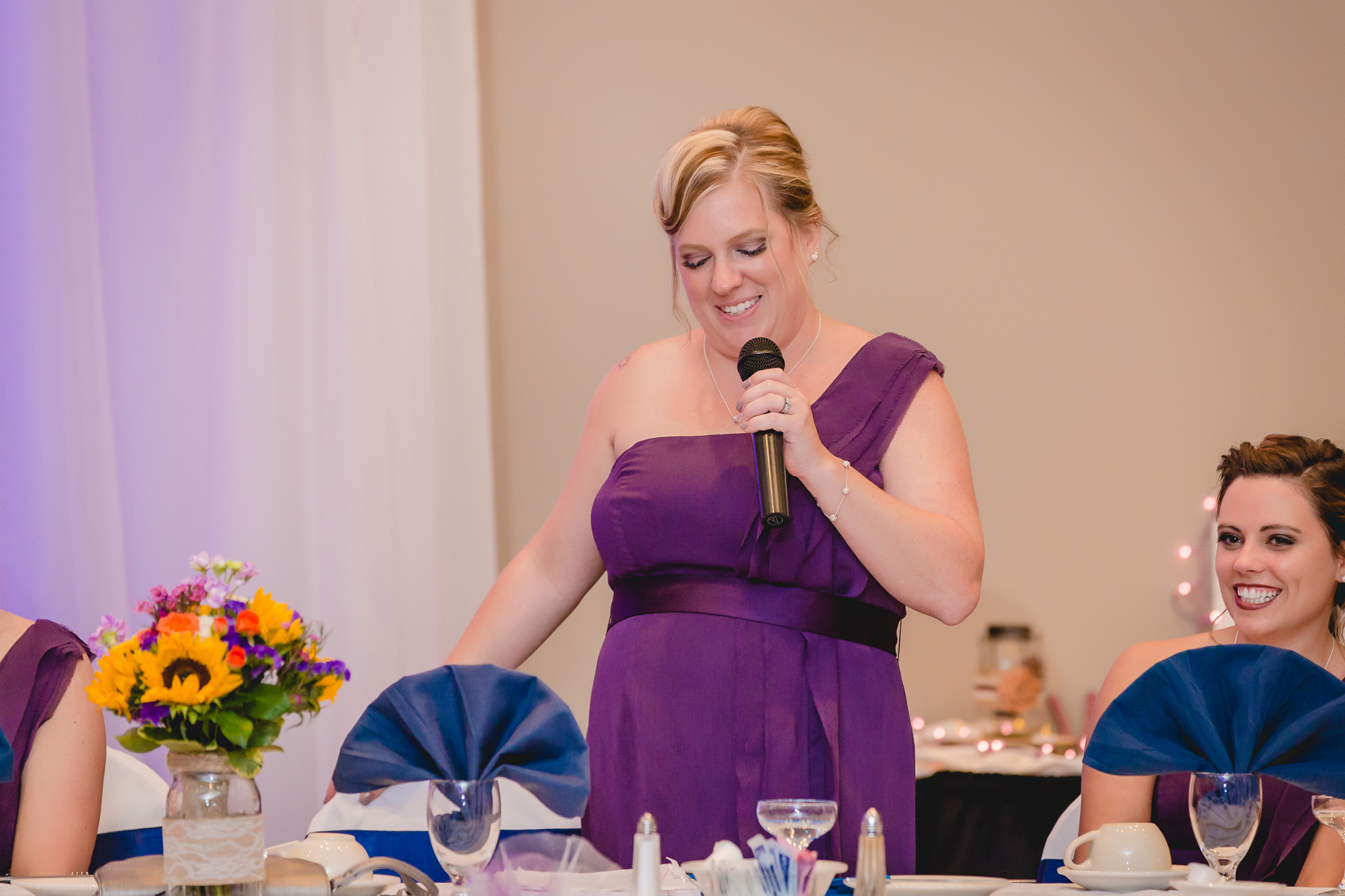 Matron of honor gives a speech at a wedding at the Fez