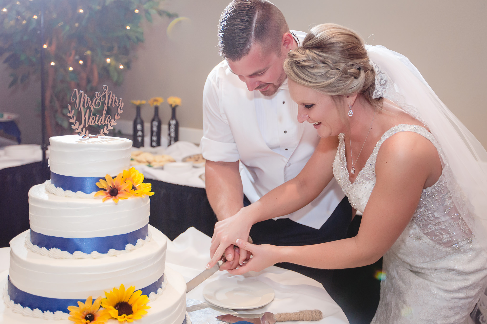 Bride and groom cut the cake at their Fez wedding reception