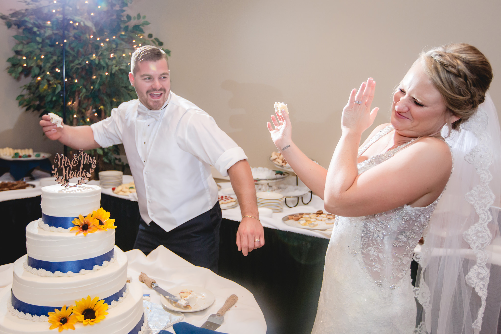 Groom threatens to smash icing in the bride's face at the Fez