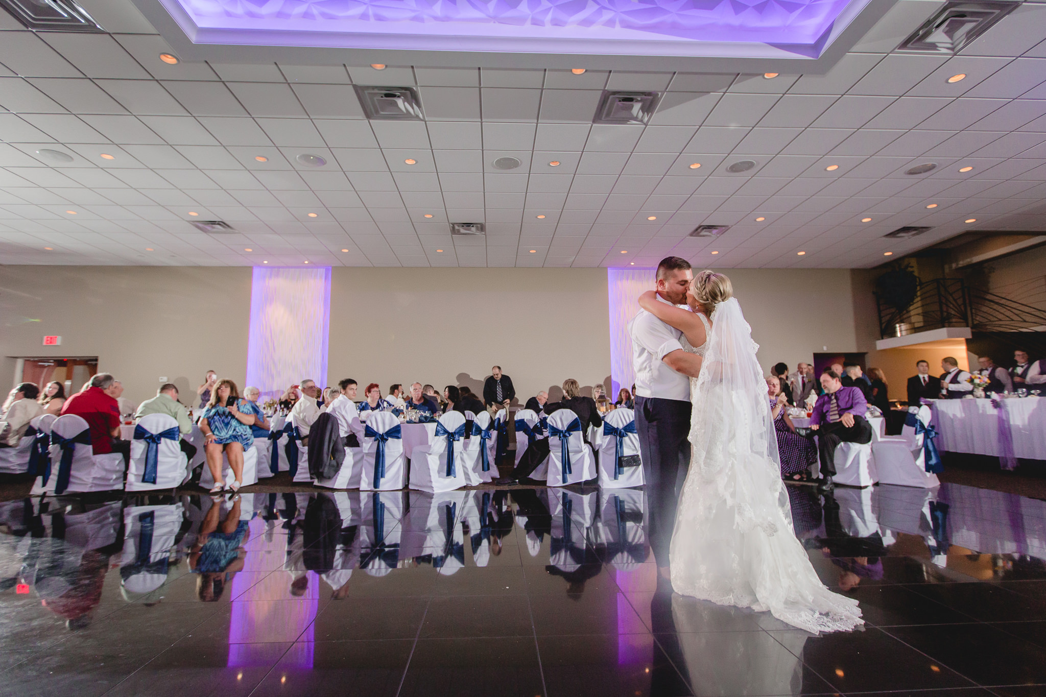 Bride and groom kiss during their first dance at the Fez