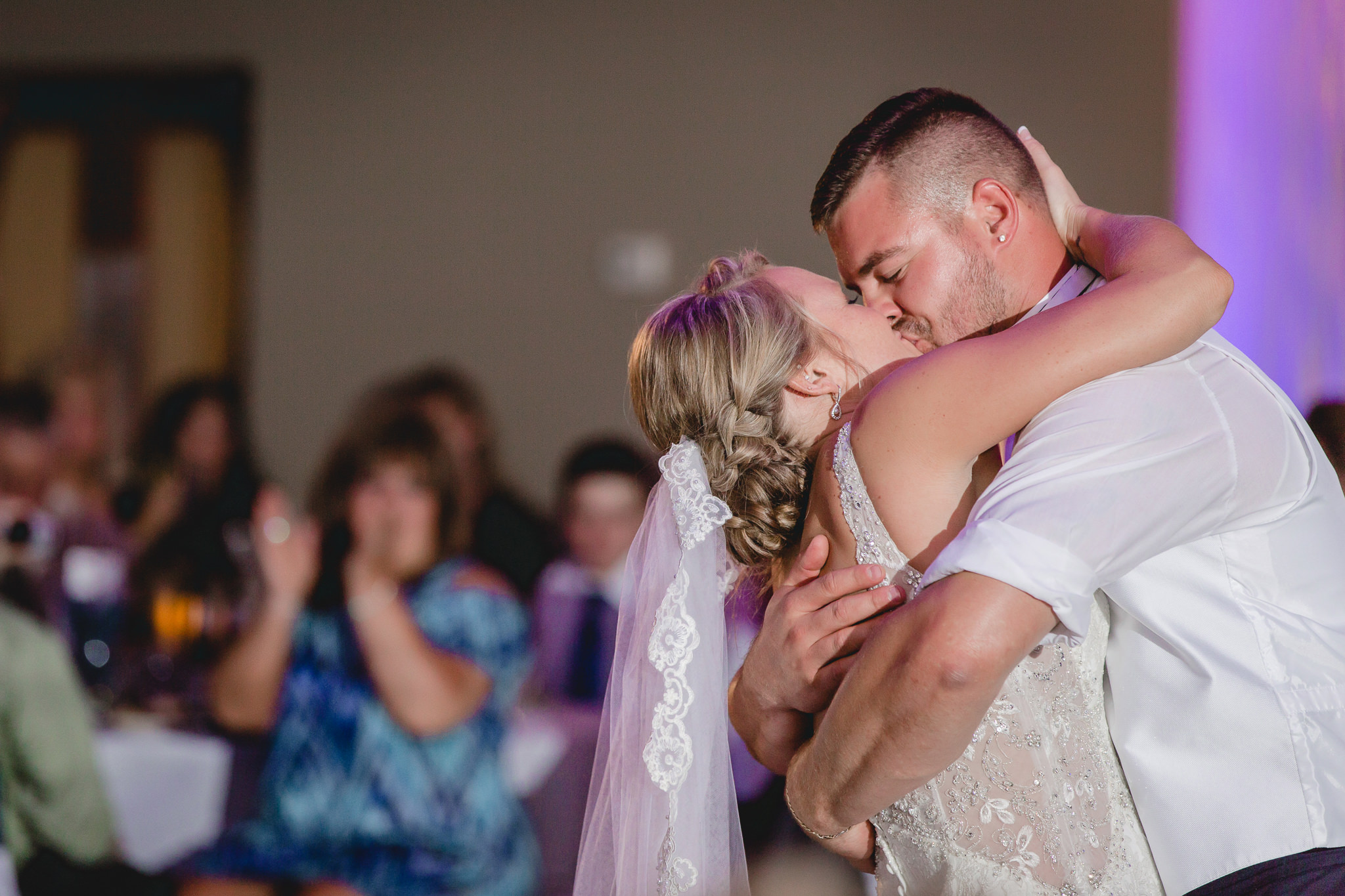 Bride and groom kiss on the dance floor at the Fez wedding reception