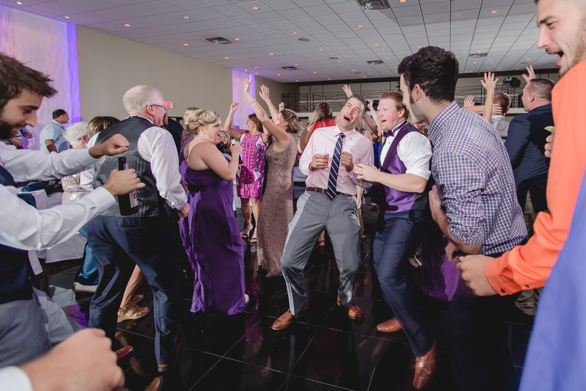 Guests dance to music at a Fez wedding reception