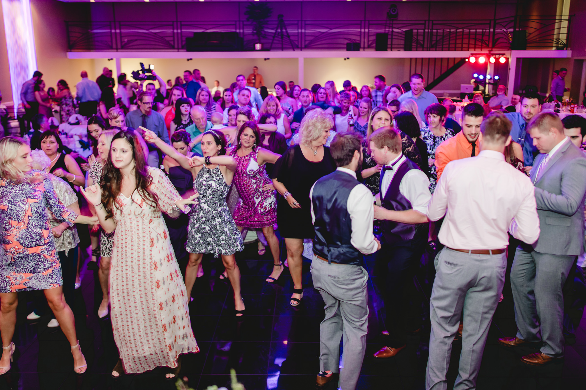 Wedding guests pack the dance floor to line dance at the Fez