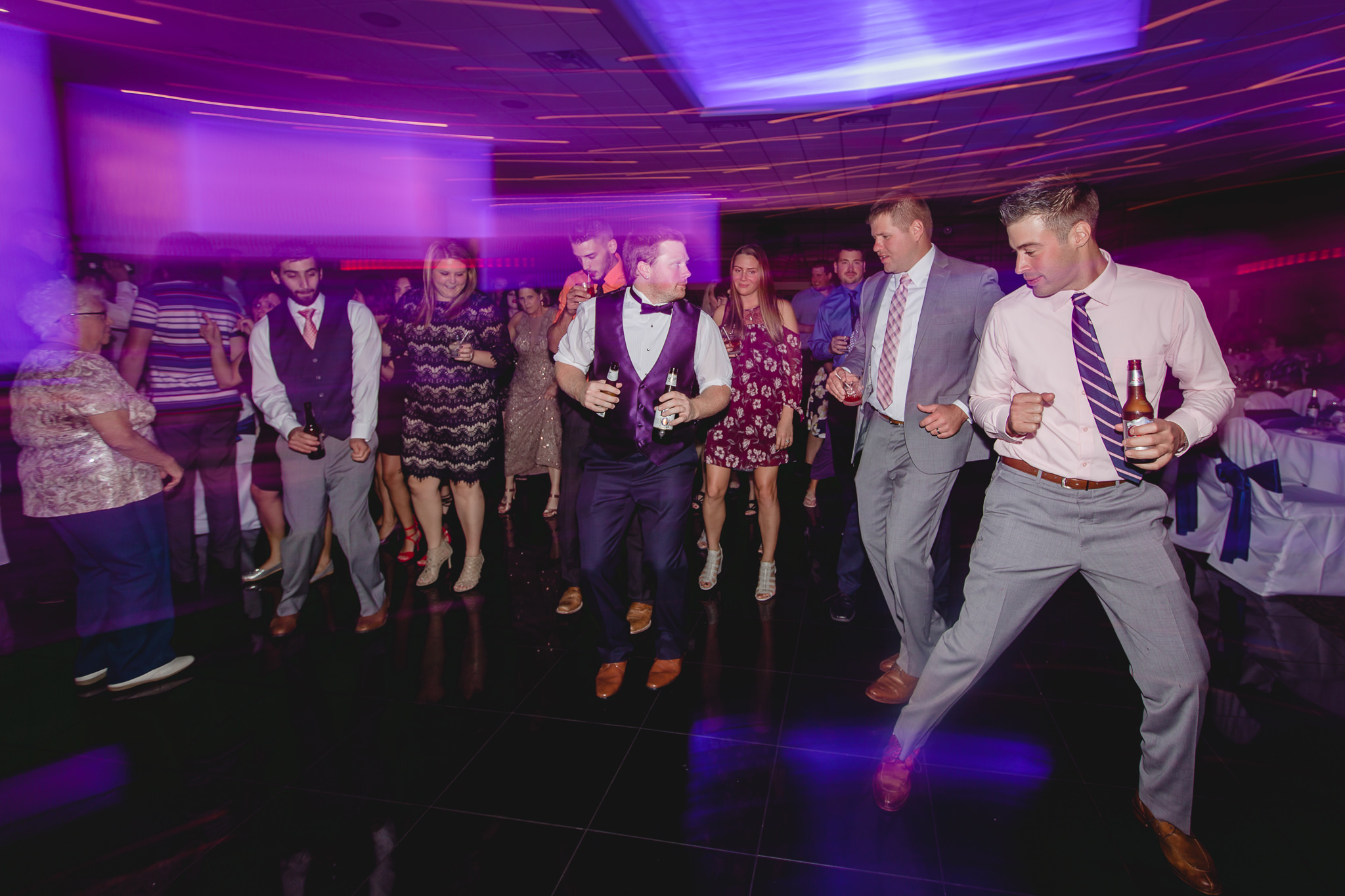 Guests dance to the Cha Cha Slide at a Fez wedding reception