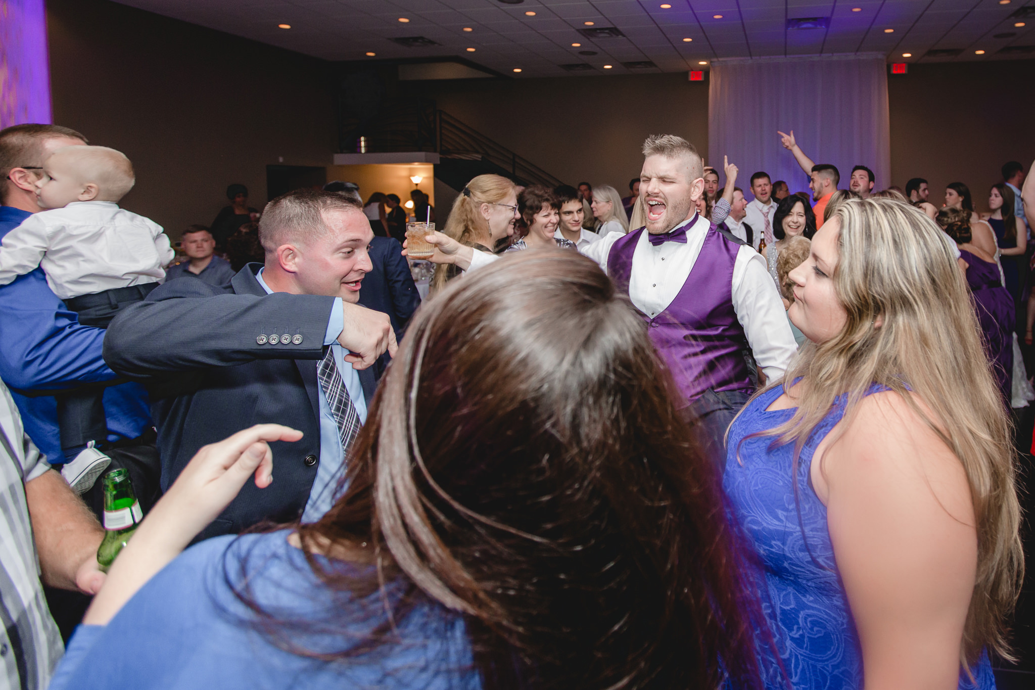 Groomsman sings on the dance floor at the Fez wedding reception