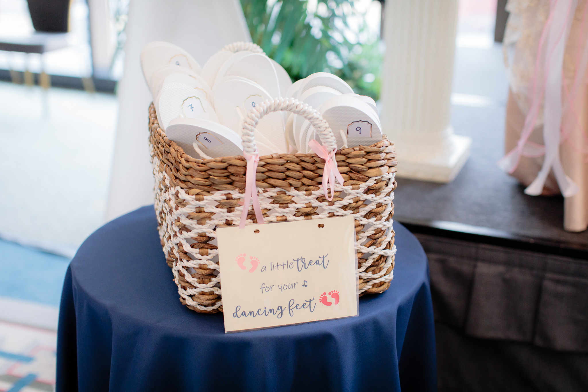 2394cde57b4bc Basket of flip flops for guests at a Duquesne University wedding reception